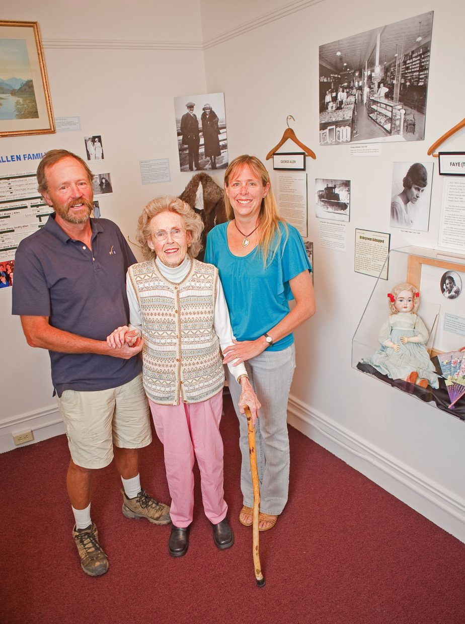 Phyllis Allen, center, stands in front of the new exhibit at the Tread of Pioneers Museum on Thursday with her son Lon Allen and daughter Gina Walker.