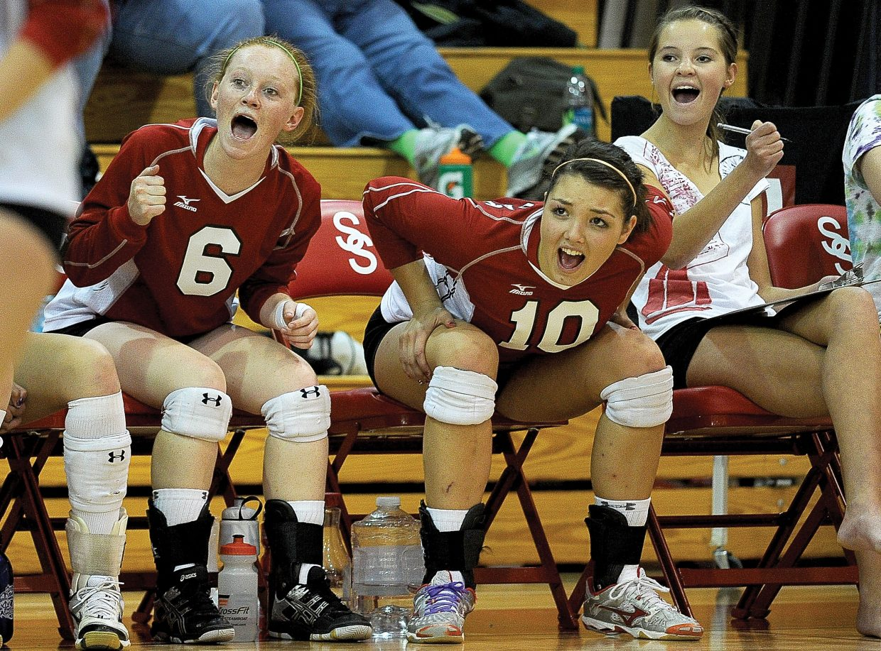 Steamboat Springs Taylor Loomis, left, and Maggie Stanford celebrate after Steamboat won Friday night's home match against Delta.