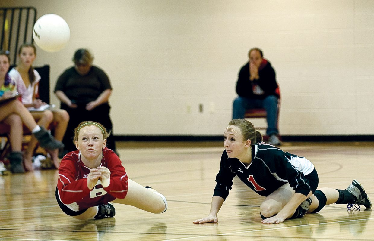 Steamboat Springs Taylor Loomis digs a ball off the floor during Friday night's match against Delta in Steamboat Springs.