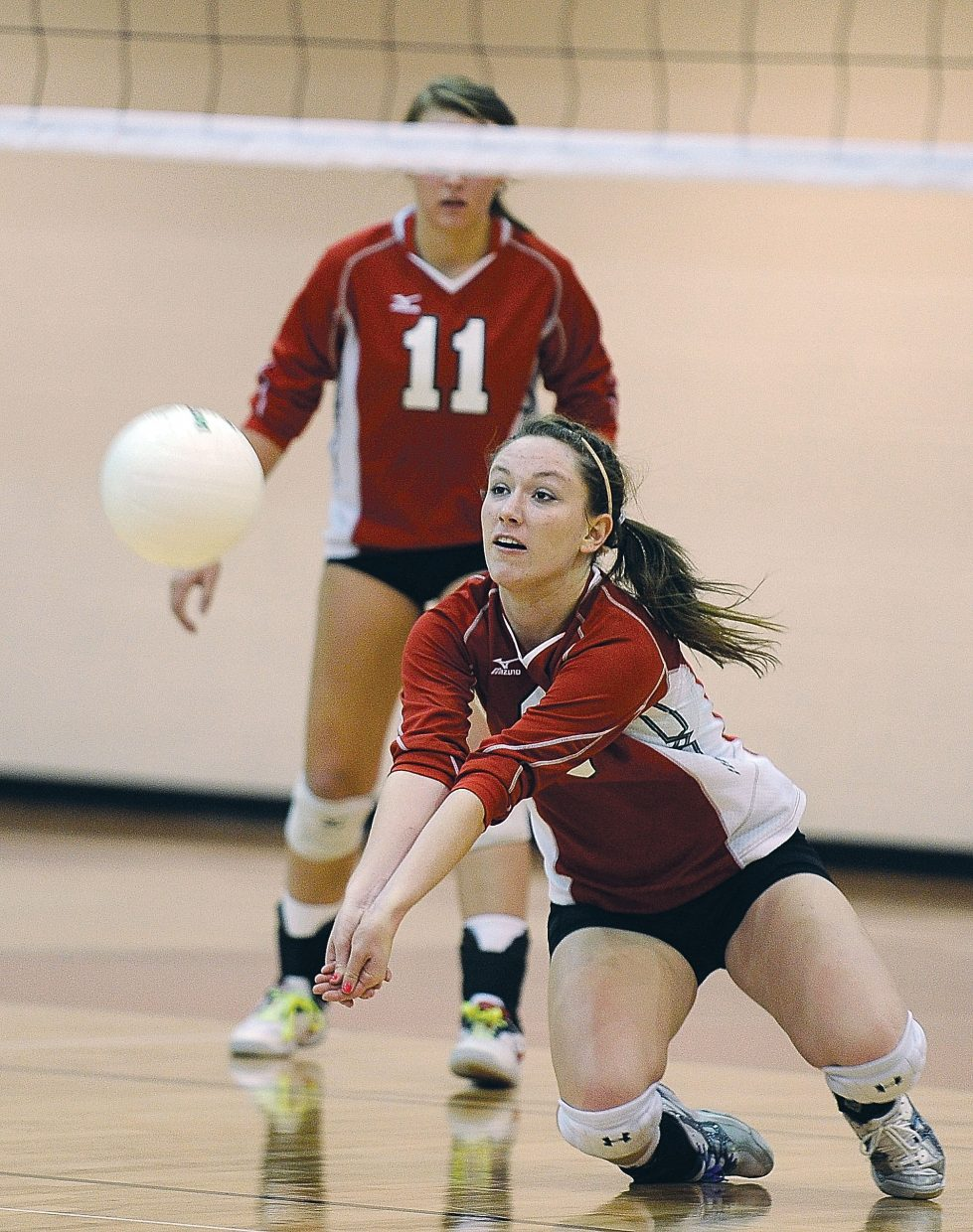 Steamboat Springs Meghan Rabbitt digs a ball during Friday night's homecoming match against Delta.