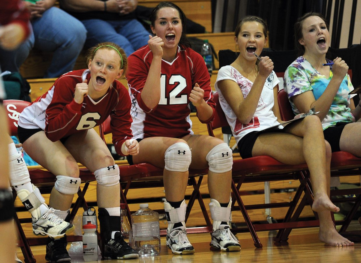Steamboat Springs Taylor Loomis, left, and Amy Brodie cheer for their teammates during a come-from-behind win against Delta on Friday night. The Sailors defeated the Panthers, 3-2, in the match.