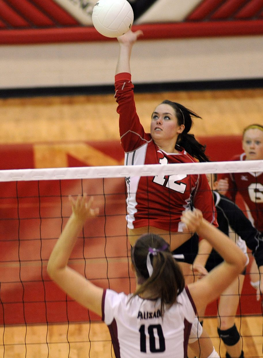 Amy Brodie hits the ball Saturday against Palisade.