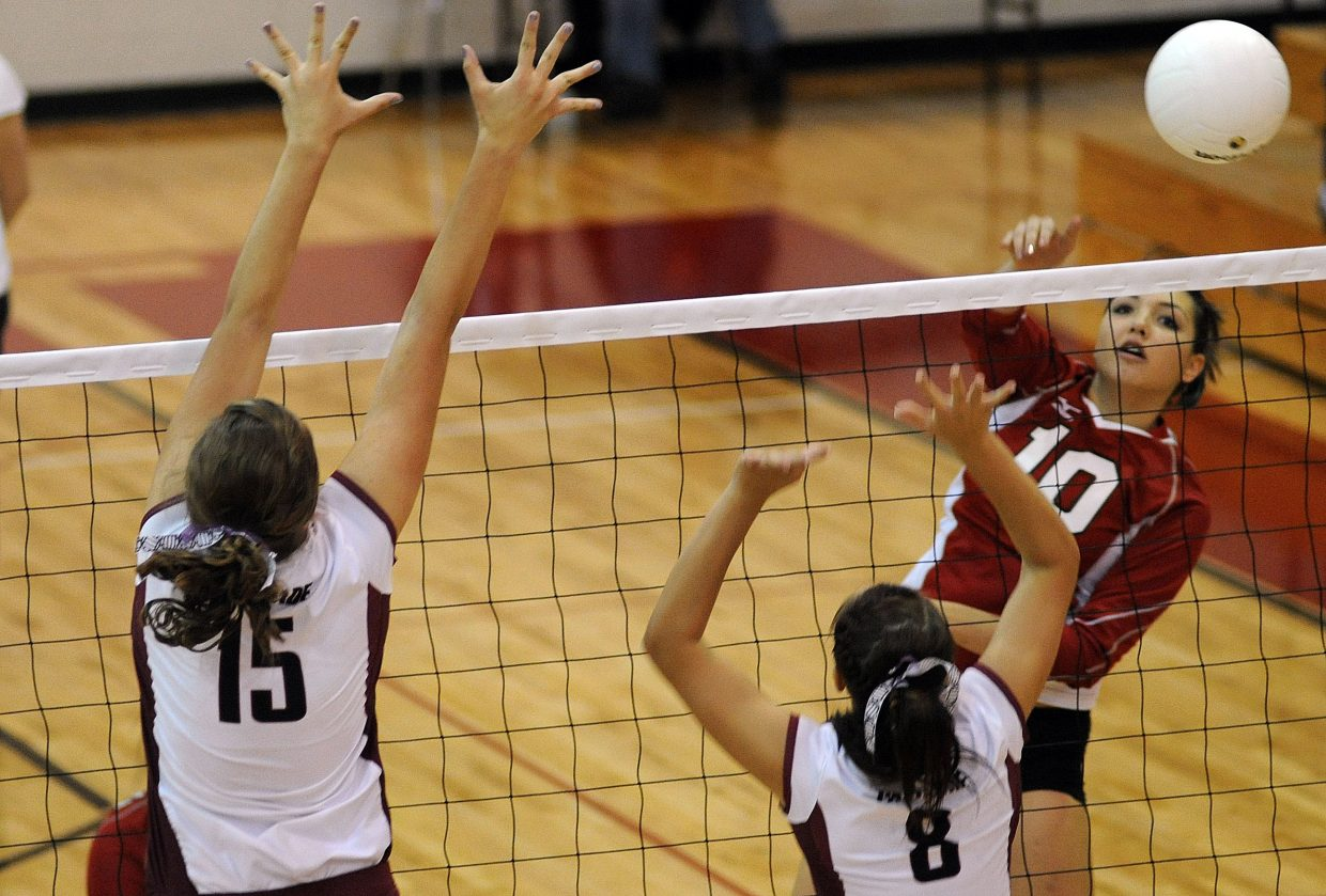 Maggie Stanford hits a ball past a Palisade block Saturday in Steamboat Springs.
