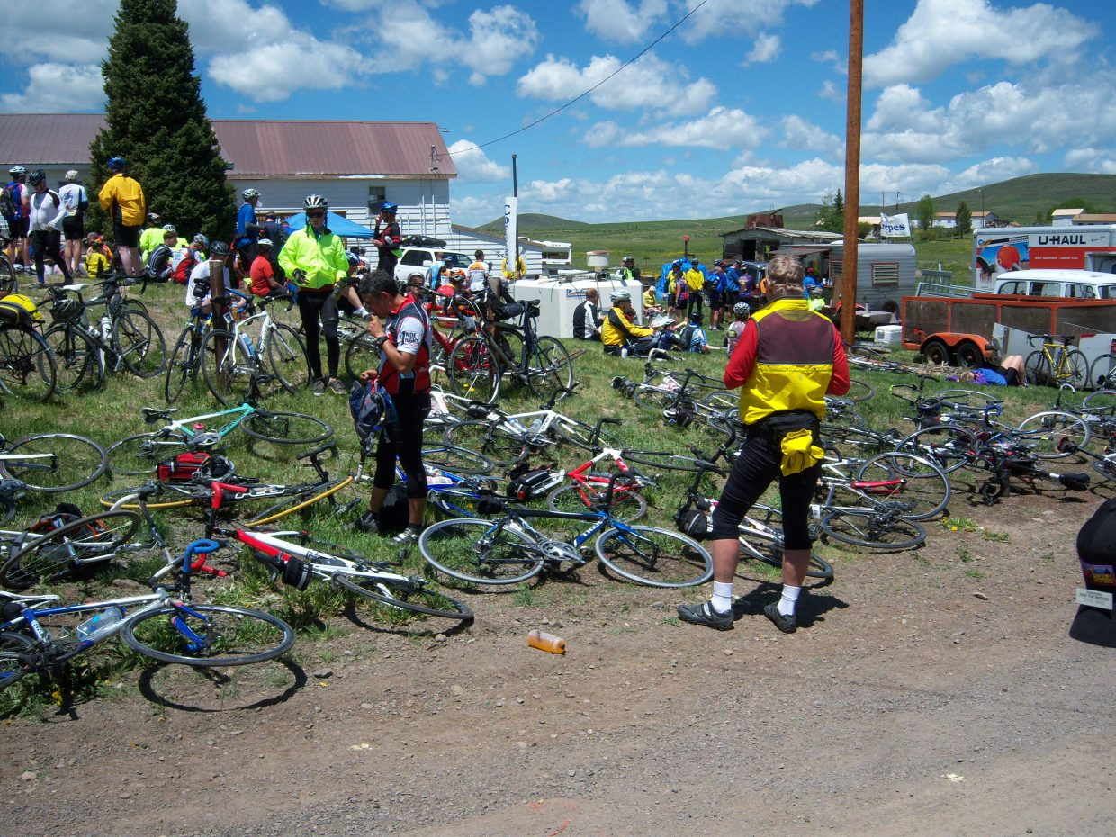 Ride the Rockies cyclists stop Tuesday at the Toponas Country General Store.