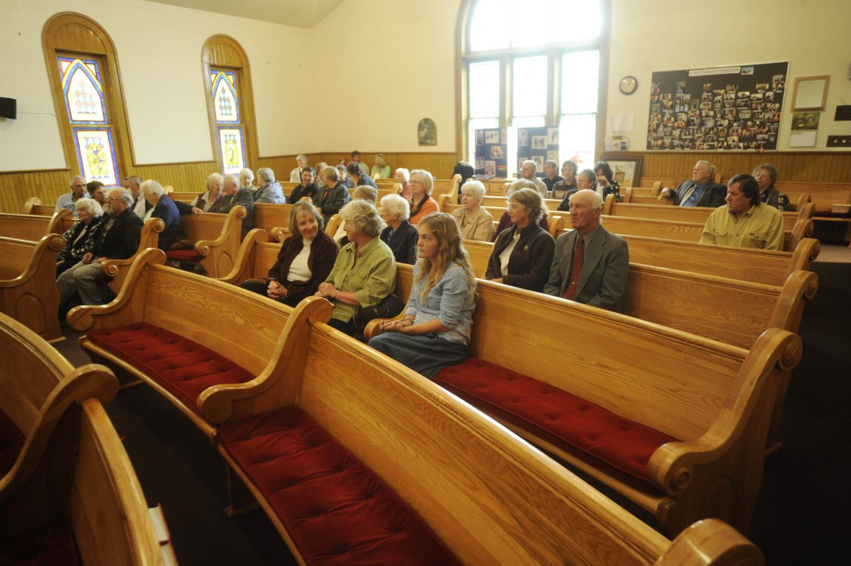 Friends fill the pews Saturday at Hayden Congregational Church for Jan Leslie's memorial service.