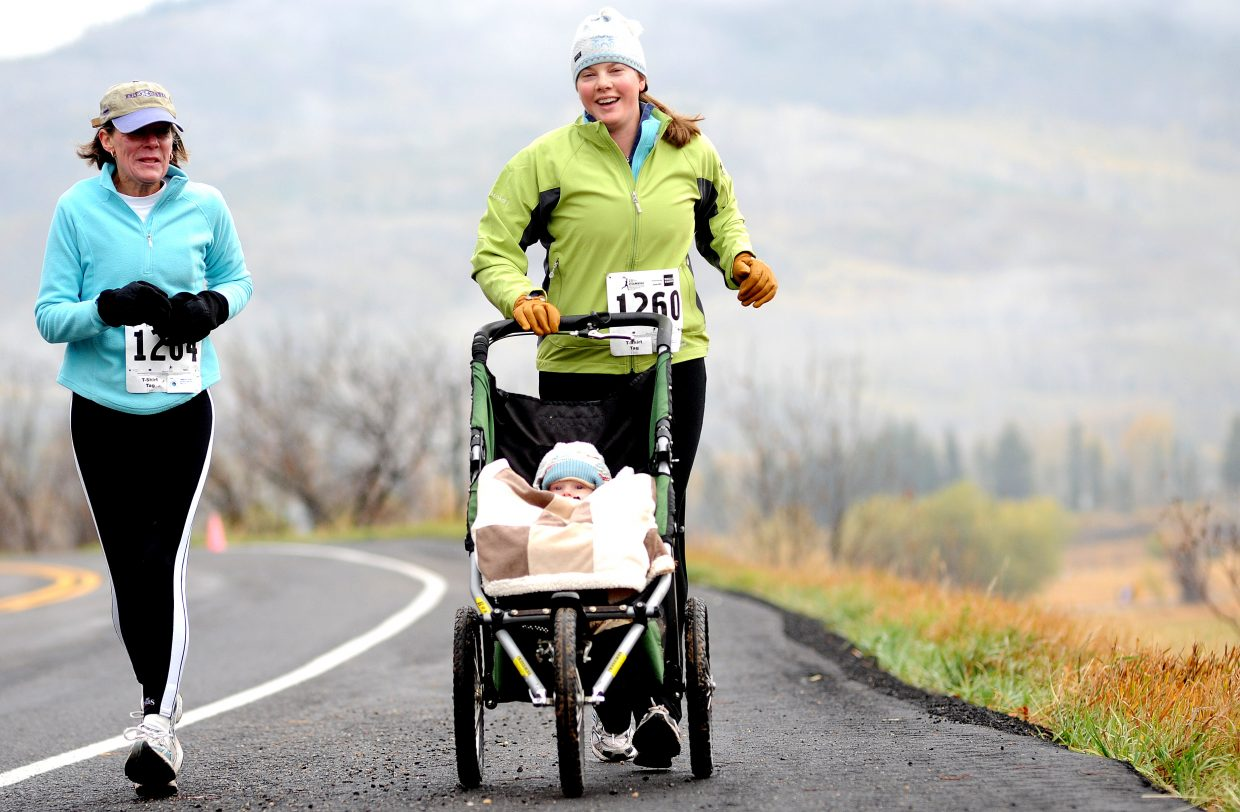 Lizzie Mathey pushes a stroller Saturday while running in the 5-kilometer Soda Creek Sneak race in Steamboat Springs.