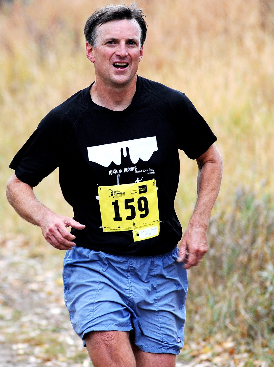 Allen Belshaw runs in Saturday's Soda Creek Sneak. He won the men's division of the 10-kilometer race.