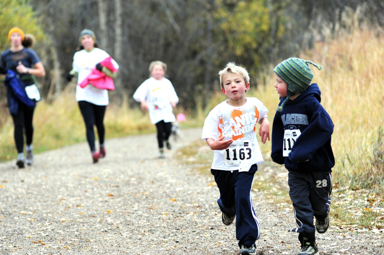 Gabriel Gray, right, and Andrew Kempers lead a pack of runners on Saturday during the inaugural Soda Creek Sneak race in Steamboat Springs.