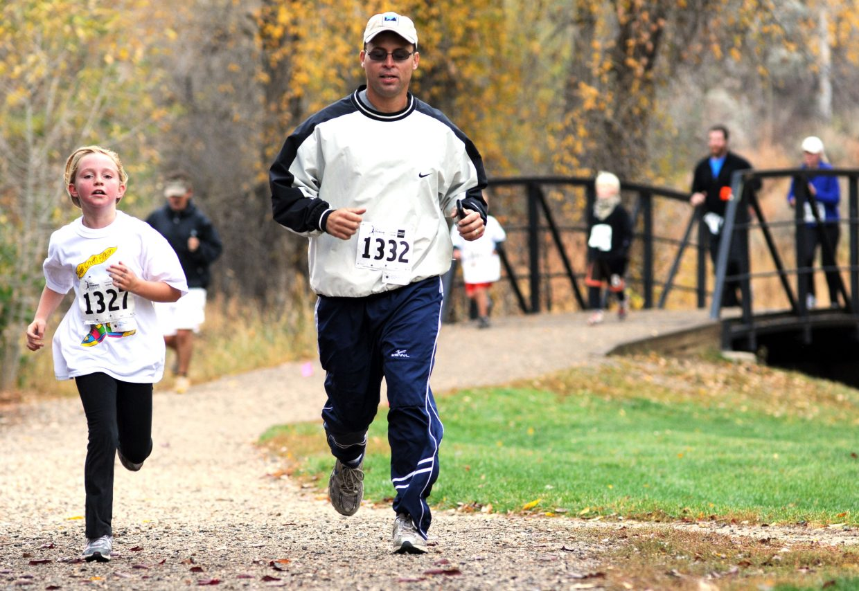 Alexa Paoli, left, and Chris Paoli run Saturday in the Soda Creek Sneak in Steamboat Springs.