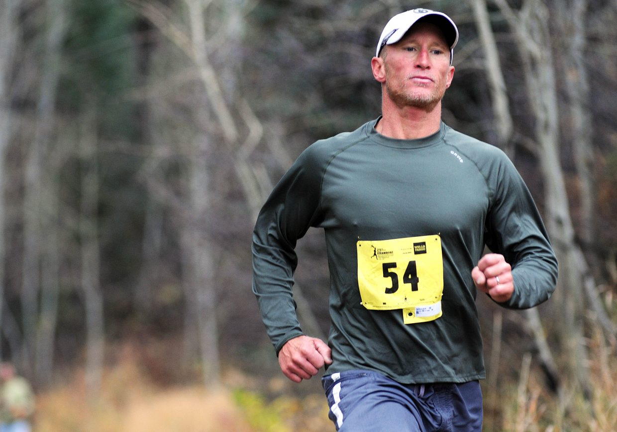 Neill Redfern runs Saturday in the 10-kilometer race of the Soda Creek Sneak in Steamboat Springs.