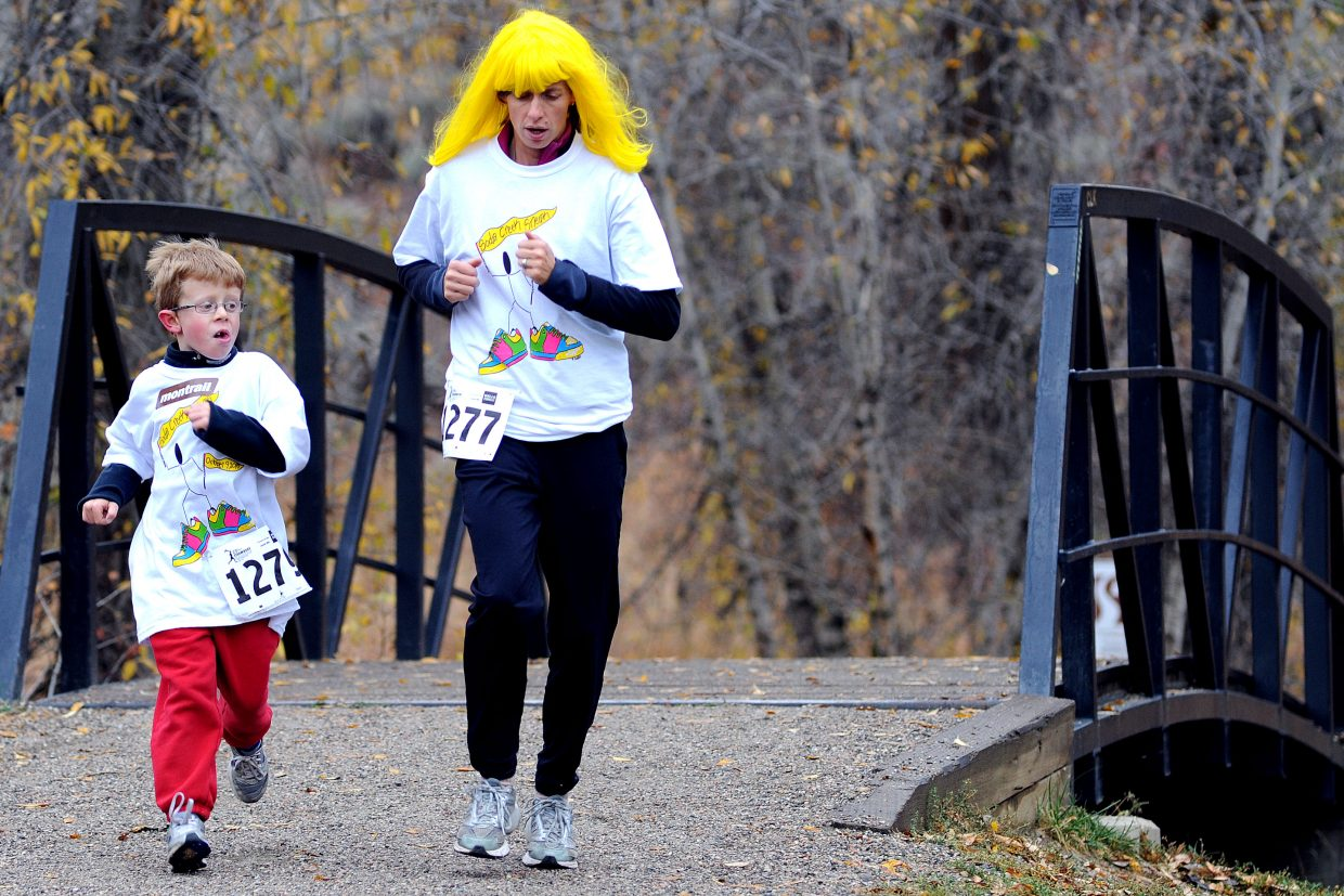 Tommy Meissner and Liz Meissner run Saturday in the Soda Creek Sneak in Steamboat Springs.