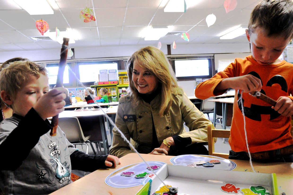 Colorado Sen. Jean White, center, watches South Routt Elementary students William Meckley-Kochenower, left, and Alan Mayer fish on Tuesday during class. White is touring all of the schools she represents in the legislature to learn about the new programs they are introducing and see how their classrooms have been affected by budget cuts.