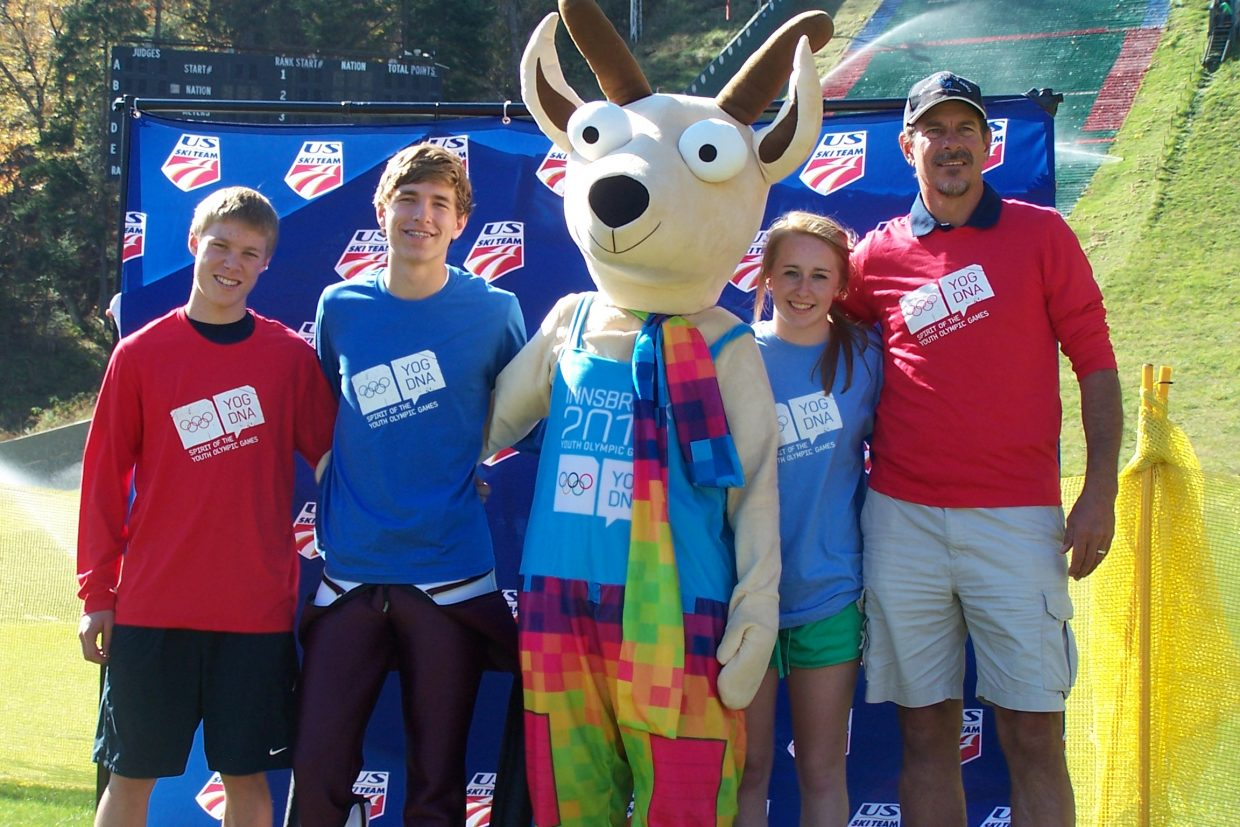 Steamboat's Ben Berend, left, and teammate A.J. Brown, Winter Youth Olympic Games mascot Yoggl, teammate Emilee Anderson and 2012 Winter Youth Olympic Games Nordic coach Gary Crawford celebrate after the Flaming Leaves Festival in Lake Placid, N.Y. The four are heading to the inaugural games January in Austria.