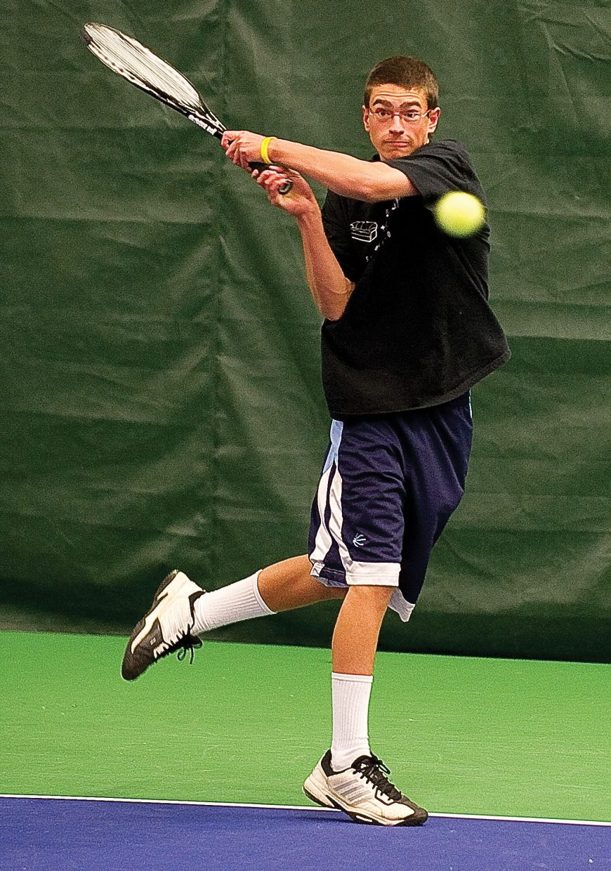 Steamboat Springs Kyle Rogers returns a volley while practicing with his Steamboat Springs High School teammates Tuesday afternoon at the Tennis Center at Steamboat Springs. The team will leave today for the 4A State High School Tennis Championships in Pueblo.