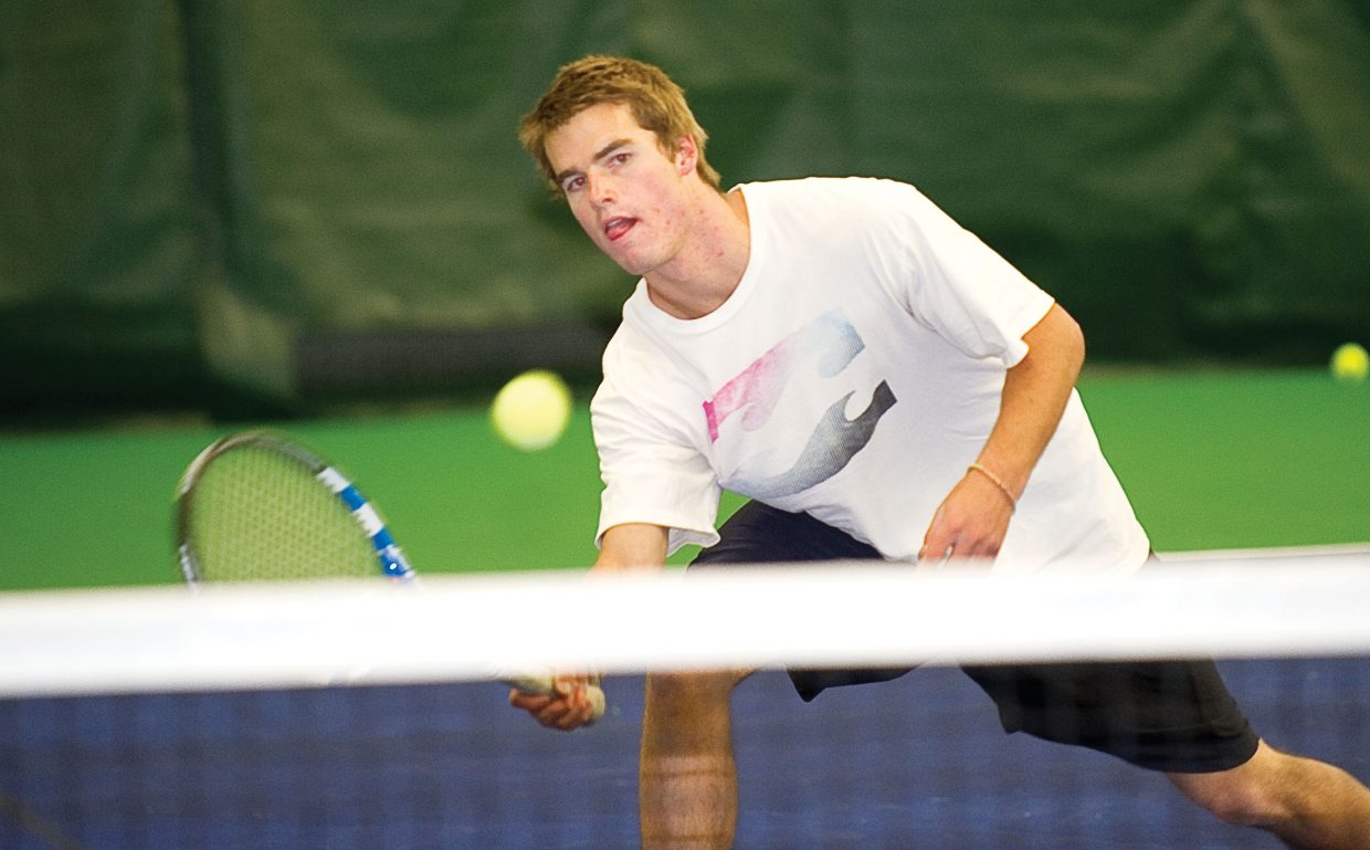 Steamboat Springs Luke Farny returns a volley while practicing with his Steamboat Springs High School teammates Tuesday afternoon at the Tennis Center at Steamboat Springs. The team will leave today for the state high school tennis championships in Pueblo.