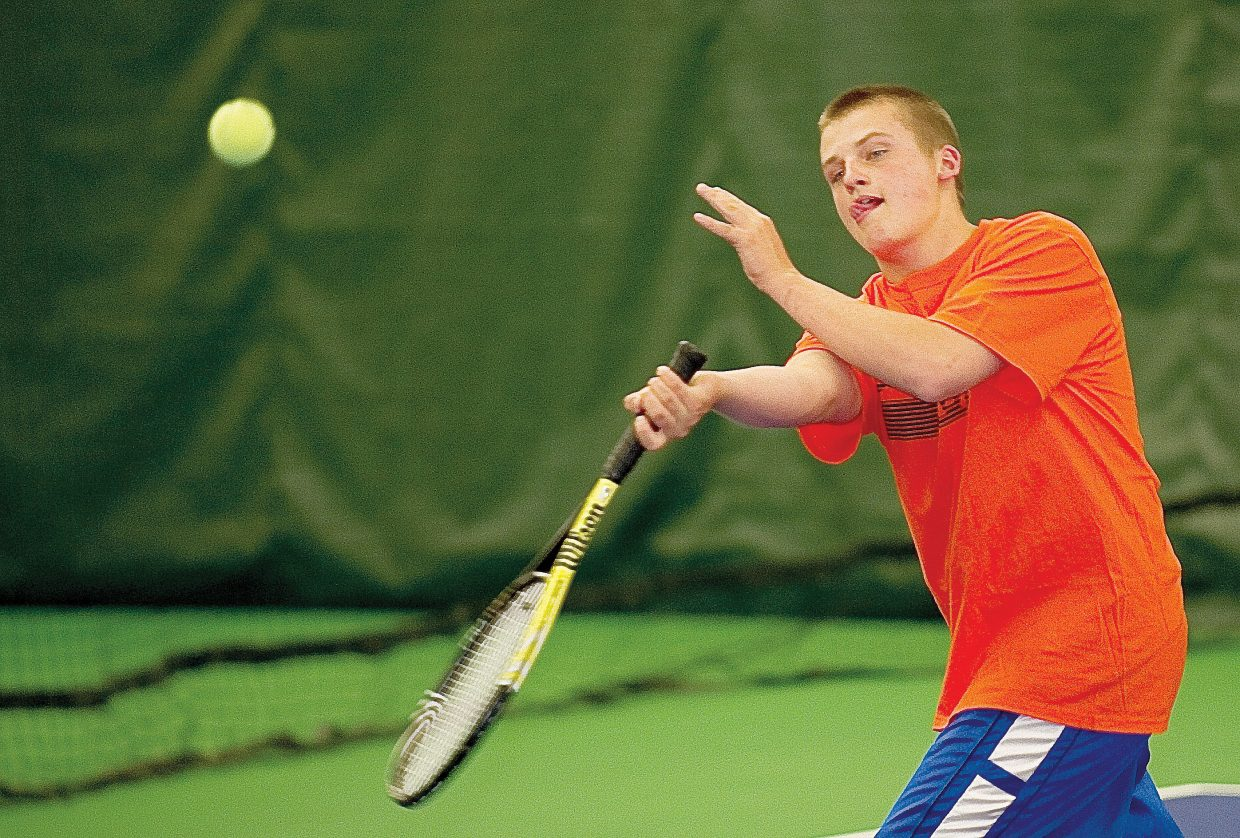 Karsten Thompson returns a volley while practicing with his Steamboat Springs High School teammates Tuesday afternoon at the Tennis Center at Steamboat Springs. The team leaves Steamboat on Wednesday for the state high school tennis championships in Pueblo.
