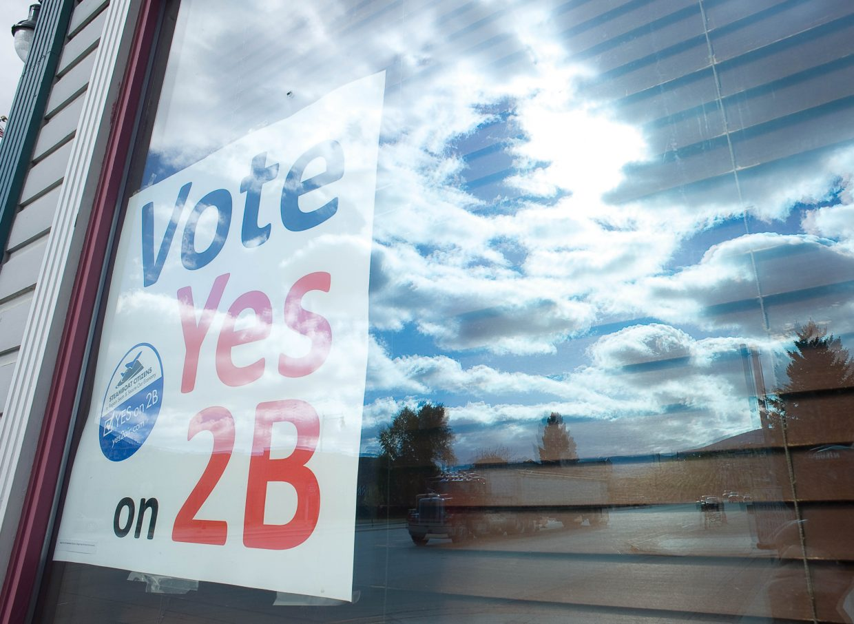 A sign inside a window at Old Town Pub urges voters in Steamboat Springs to support Referendum 2B, a ballot initiative that raises the city sales tax by 0.25 percent to pay for airline revenue guarantees.