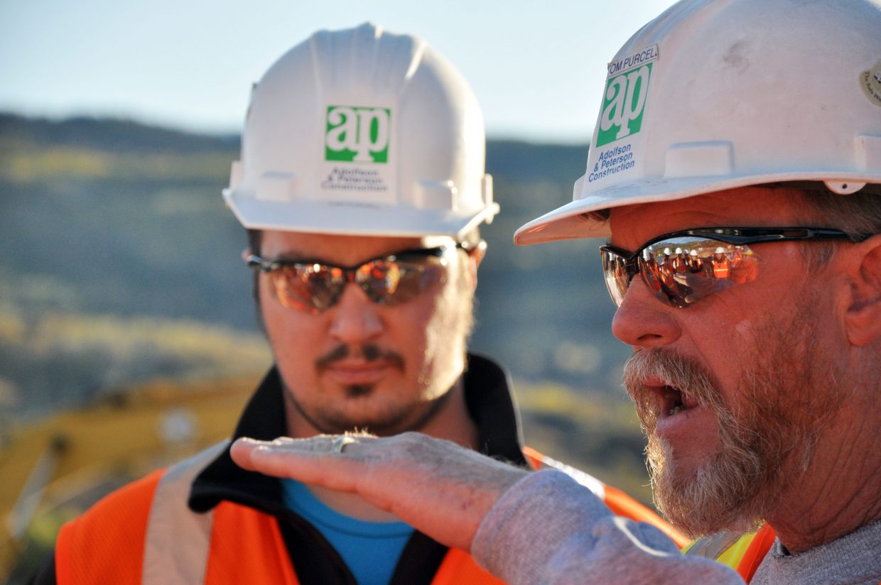 Tom Purcell, superintendent for Adolfson & Peterson Construction, tells a group of Colorado Mountain College engineering students how a geoexchange field that will heat and cool the Alpine Campus' new academic facility was installed.