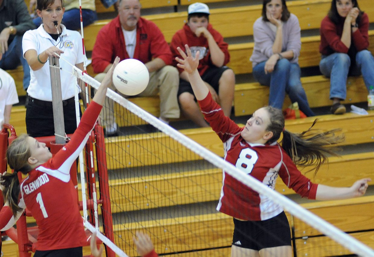 Steamboat's Nikki Fry taps the ball over the net Thursday as the Sailors faced Glenwood Springs. Fry scored on the play, but Steamboat lost the match, falling in four games.