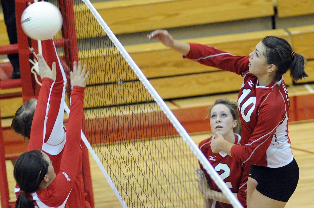 Steamboat senior Maggie Stanford rockets a ball over the top of the Glenwood Springs block Thursday night.