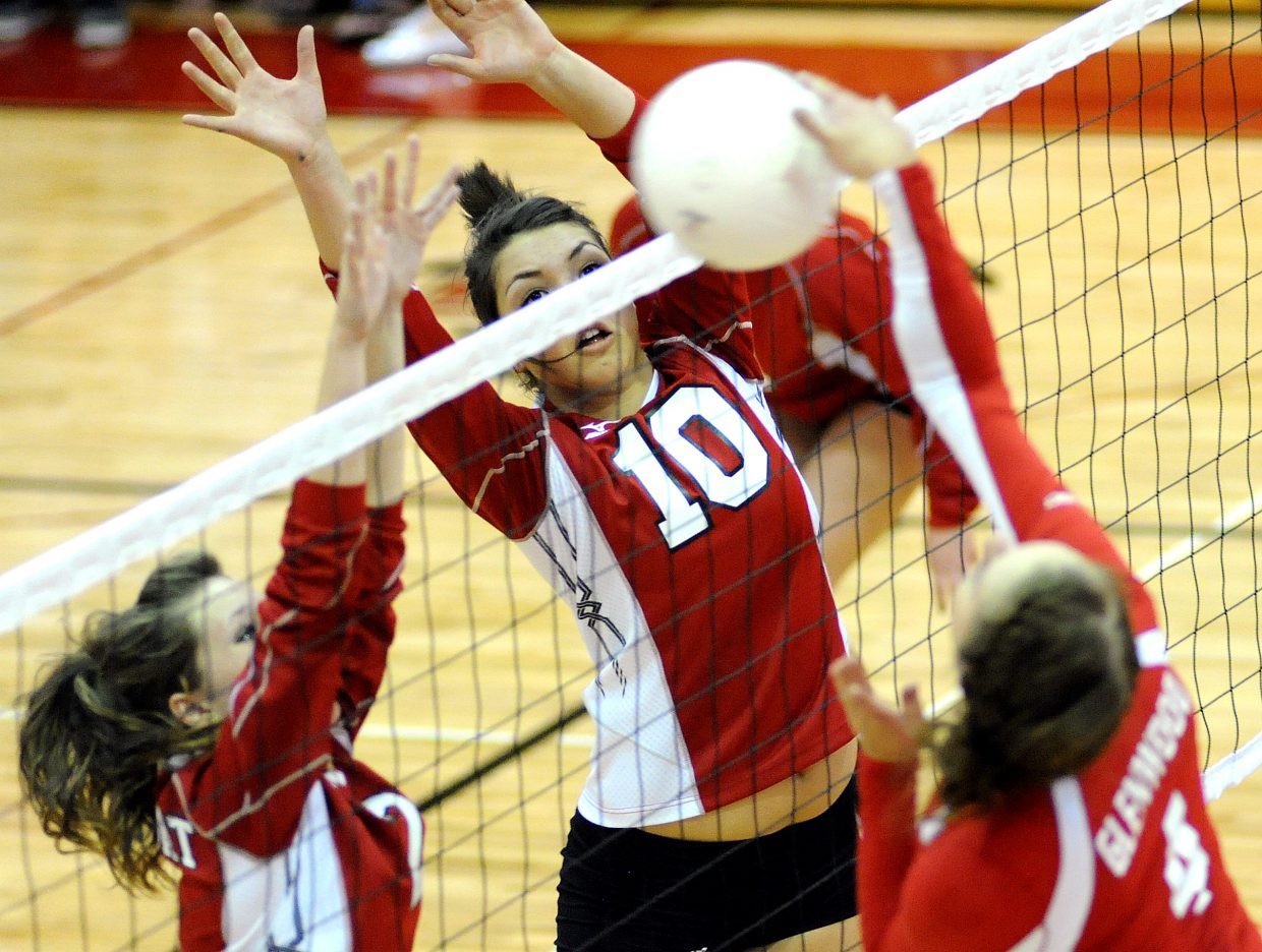 Steamboat's Maggie Stanford, right, and Callie Hvambsal go up for a block Thursday against Glenwood Springs.
