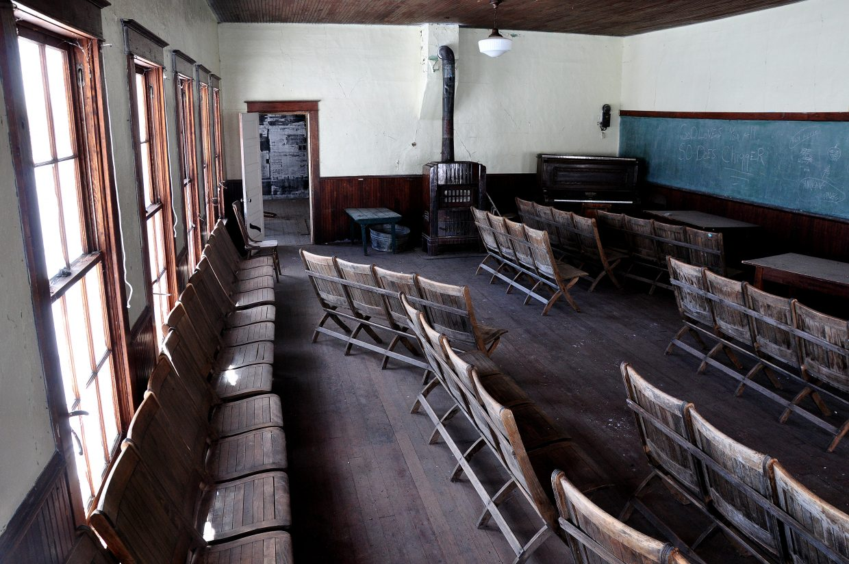 Although the Cow Creek Schoolhouse has been neglected for years, old wooden chairs and 100-year-old textbooks still remain inside the building.