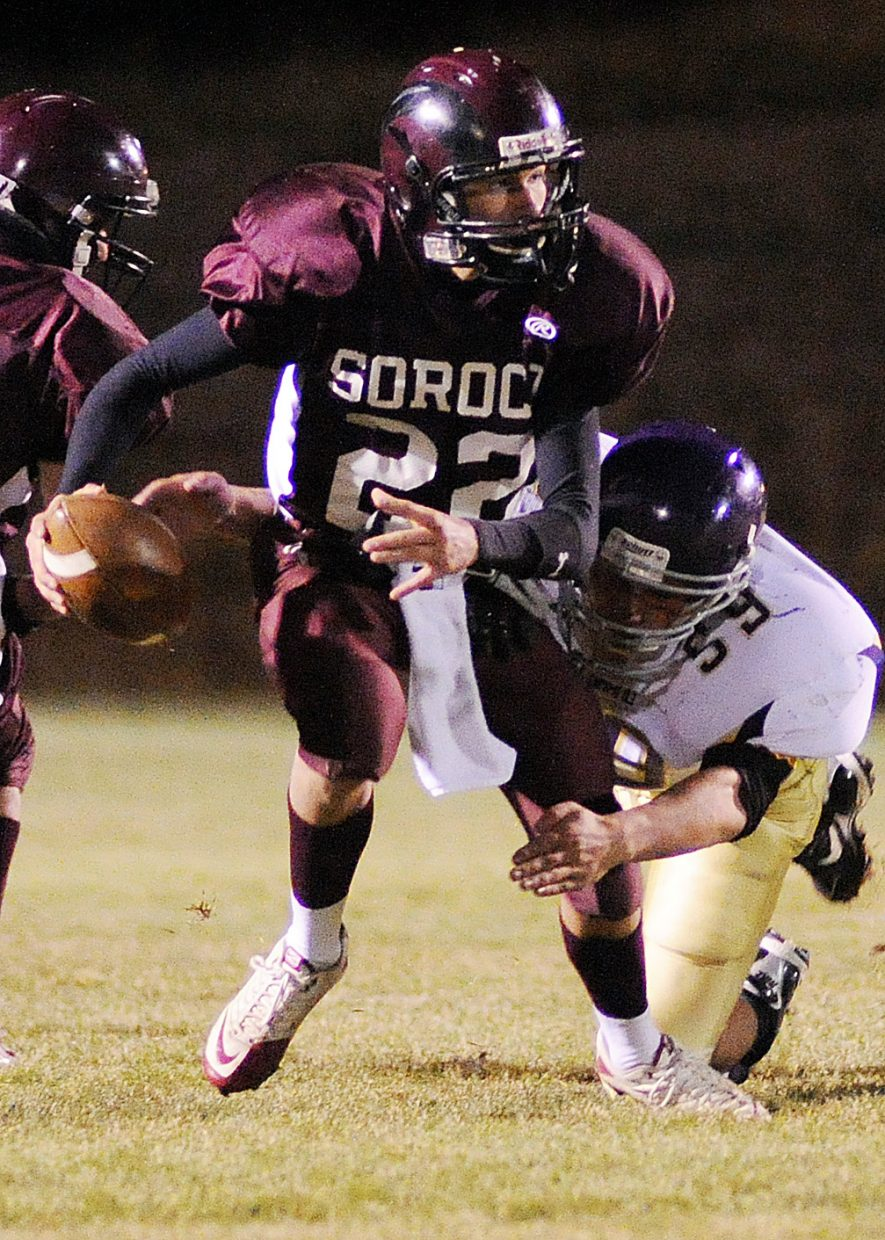 Soroco quarterback Nic Paxton tries to elude a defender Friday against West Grand.