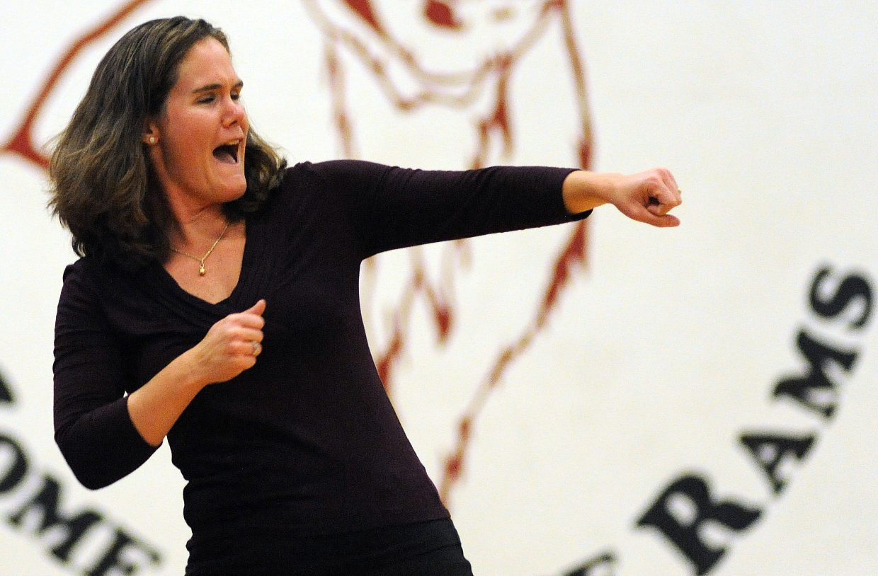 Soroco volleyball coach Kim Reeves celebrates her team's comeback victory Friday night against Vail Mountain.
