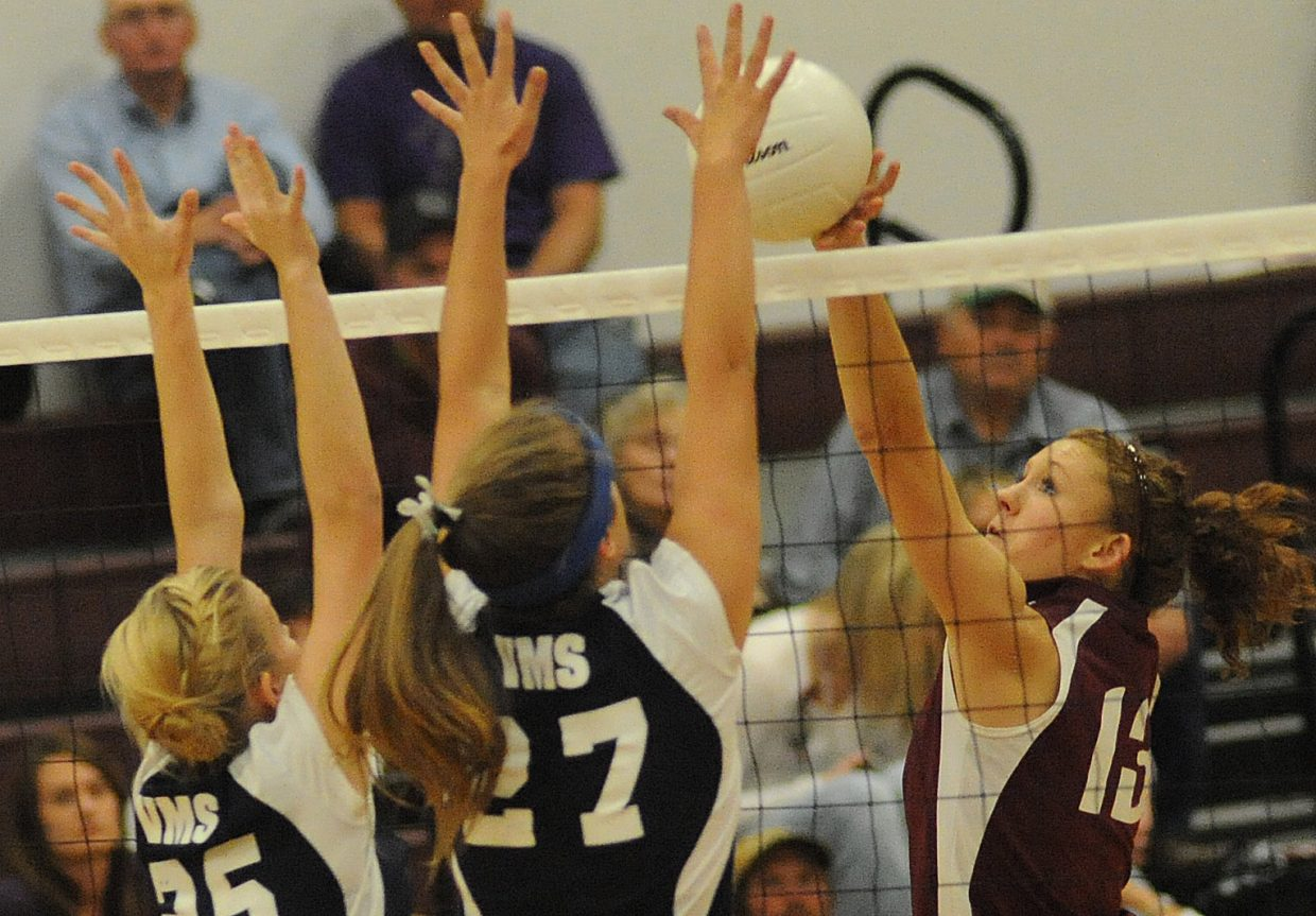 Micaela Meyer taps the ball over the net Friday against Vail Mountain.