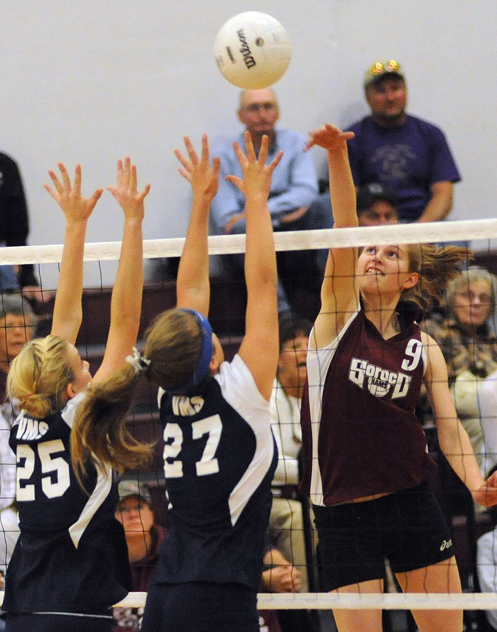 Soroco's Josie Rossi taps the ball over the defense Friday.