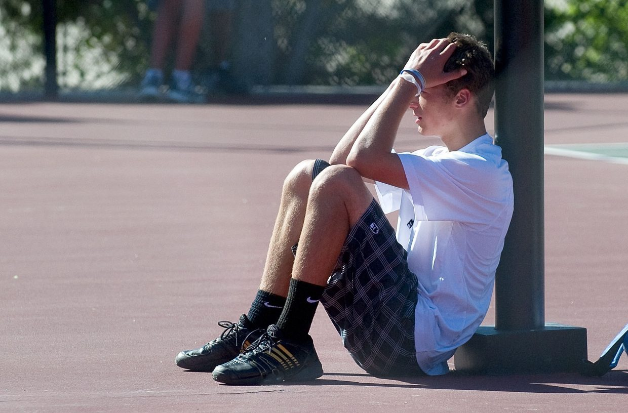 Steamboat Springs senior Keegan Burger sits on the court after losing to Niwot's Harrison Lang, 6-3, 6-3, in the semifinals of the No. 1 singles bracket at the state high school tennis championships in Pueblo.