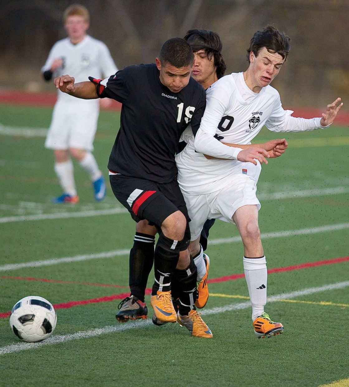 Steamboat Springs John Vande Velde collides with Eagle Valley's Jose Gonzalez while attempting to move the ball along the sideline in the first half of Tuesday night's game at Gardner Field in Steamboat Springs. The Sailors won, 7-1.