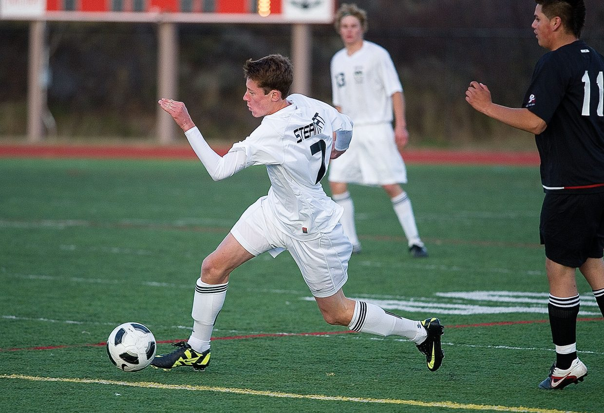 Steamboat Springs High School junior Hanson Buchner moves the ball through the Eagle Valley defense in the first half of Tuesday night's game at Gardner Field in Steamboat Springs. The Sailors won, 7-1.