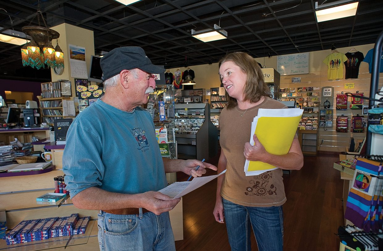 Joe Kboudi, who has owned All That Jazz in Steamboat Springs for 34 years, talks with Kim Haggarty while doing inventory at the store. Haggarty purchased the downtown business this week.