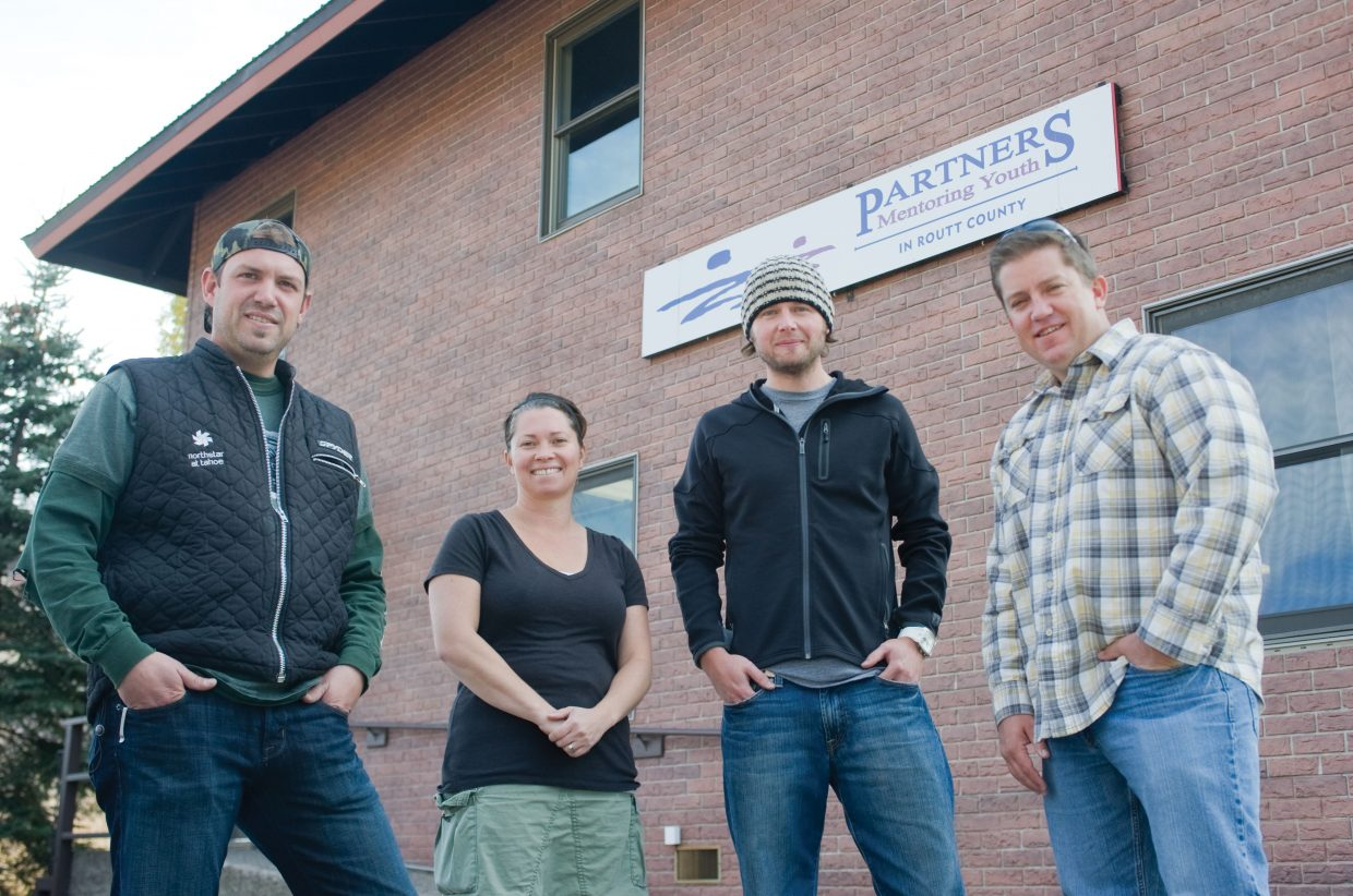 From left, Jamin McKee, Annie Dore, Todd Bischoff and Andrew Bisbee, all graphic artists in the area, are members of the nonprofit Yampa Valley Design Guild. The guild donated materials and services to build a sign for Partners in Routt County.