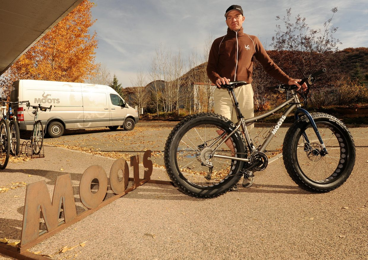 """Moots' Jon Cariveau shows off the company's new snow bike. This will be the bike's first year in production, but previous versions have been built for employees and for custom orders. Some of those models were called """"Snoots,"""" but the new version will go by """"FrosTi"""", playing on the bike's titanium frame."""