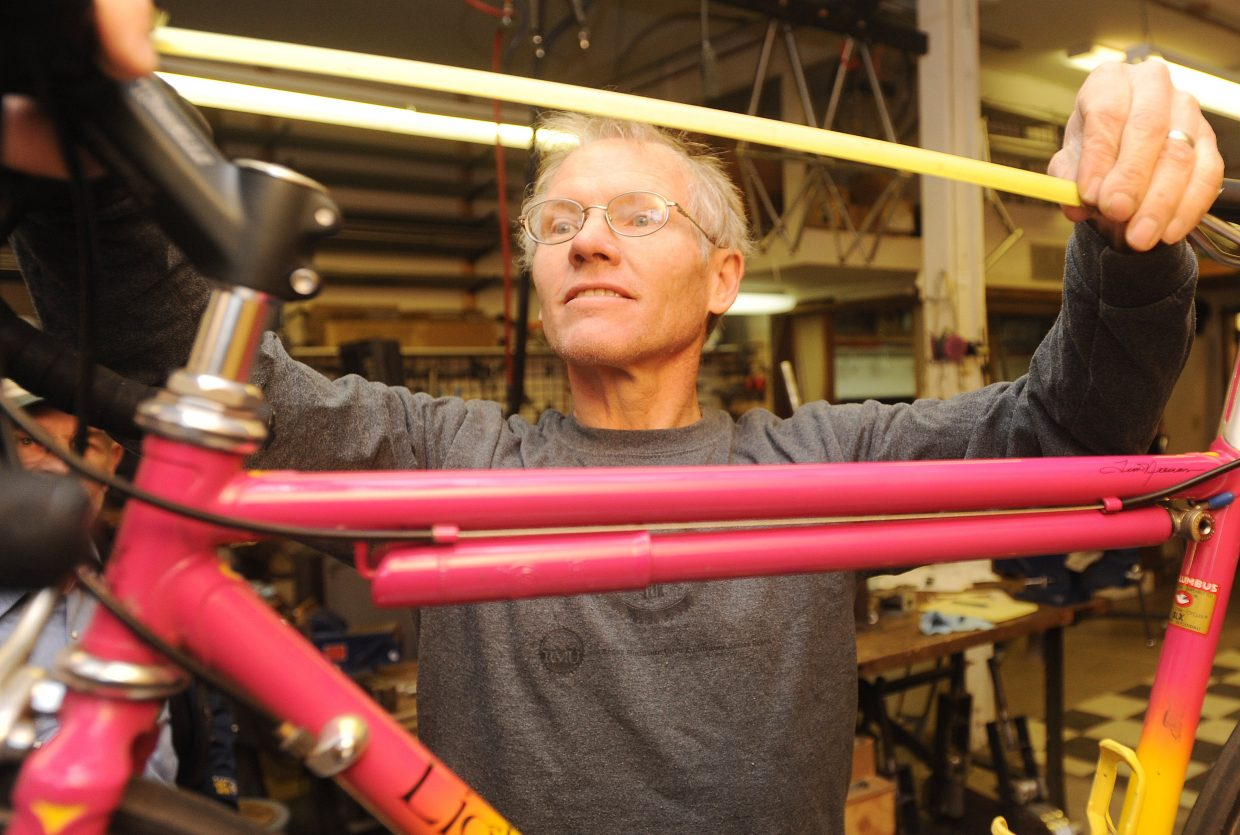 Kent Eriksen measures a customer's bike to get the size right for a new model the rider ordered. Eriksen founded Moots but left that company in 2005 to start his own Kent Eriksen Cycles, which builds custom bikes of all shape and size.