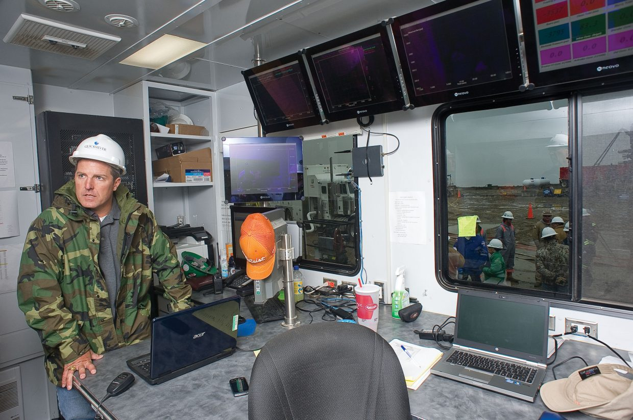Steve Lindsey, the senior director of government and communication affairs with Quicksilver Resources, listens to a question in the data van located at an oil well on Wolf Mountain in 2011.