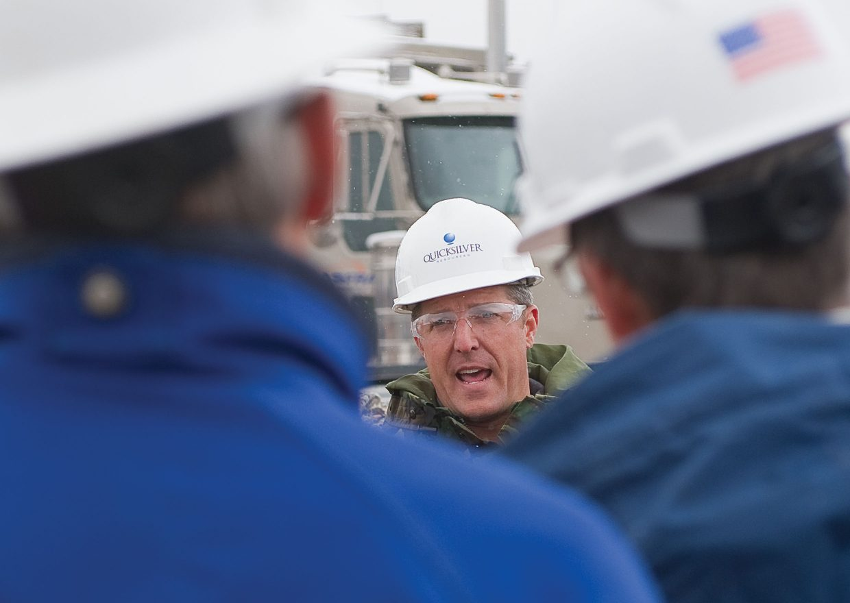 Steve Lindsey, the senior director of government and communication affairs with Quicksilver Resources, leads county officials on a tour Wednesday of an oil well on Wolf Mountain.