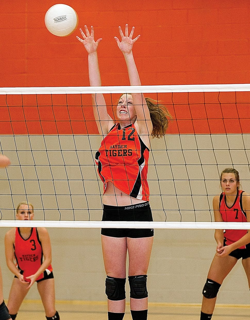 Hayden's Aubree Haskins blocks a shot at the net during Tuesday night's district playoff game against West Grand. Hayden won its first playoff game, 3-1.