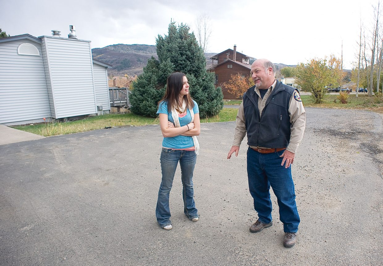Area Wildlife Manager Jim Haskins, of the Colorado Department of Parks and Wildlife, talks with Steamboat Springs resident Kayla Baumgartner on Tuesday after a neighbor reported seeing a mountain lion in the area. The neighbor reported seeing the lion Monday afternoon, and there were reports that it was seen again on Tuesday.