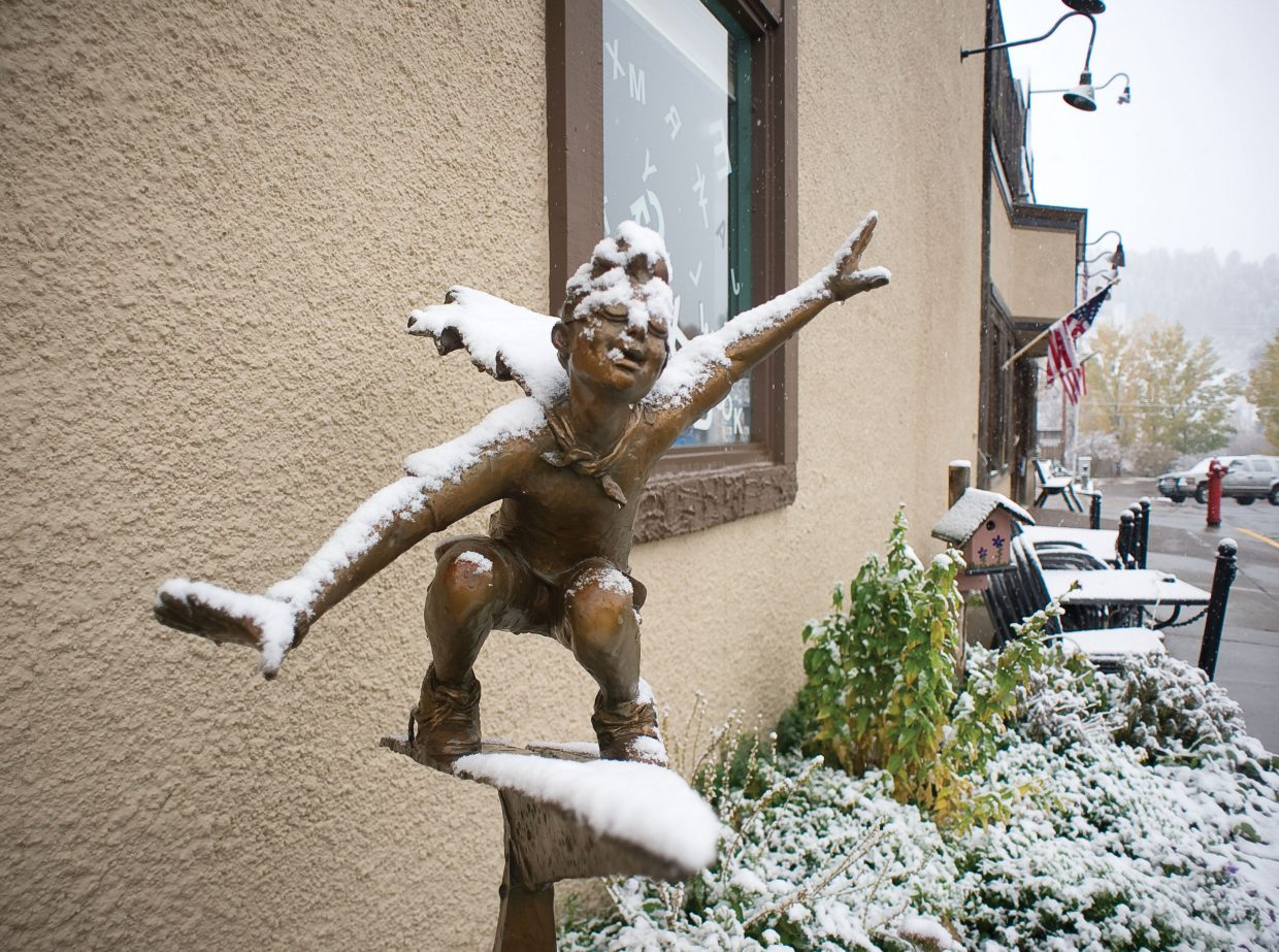 Snow covers a sculpture outside the off the Beaten Path Bookstore on Wednesday morning.