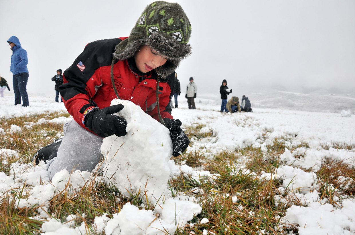 Soda Creek Elementary School fifth-grader Hudson Heil builds a snowman Wednesday at the Environmental Learning Center at Legacy Ranch. Heil's class was taking part in Yampatika's environmental literacy program.