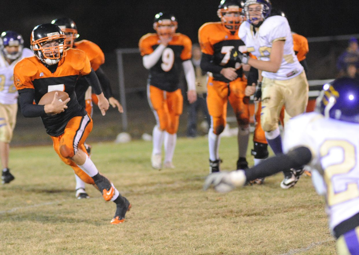 Hayden senior quarterback Graig Medvesk runs away from Lake County tacklers during the first half of Friday's lopsided win against the Panthers.
