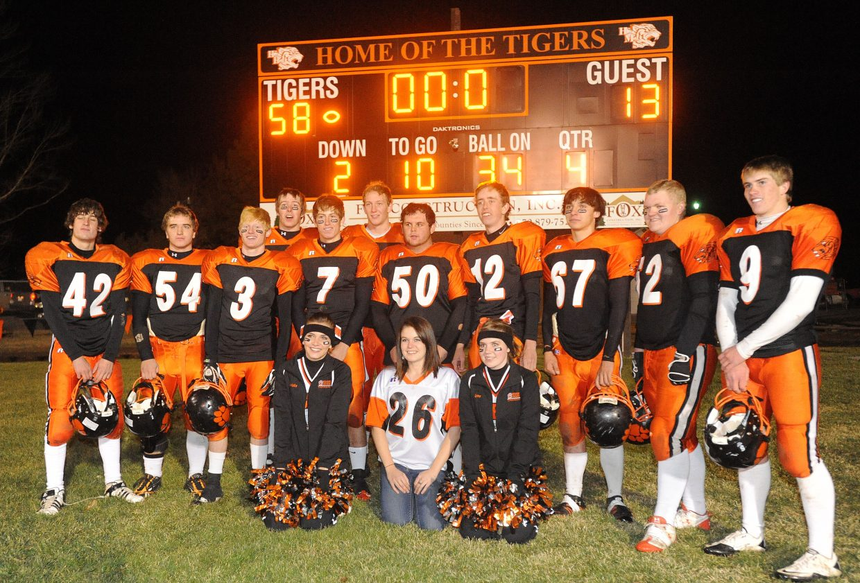 The seniors on the Hayden High School football team pose in front of the scoreboard after defeated Lake County on Friday.