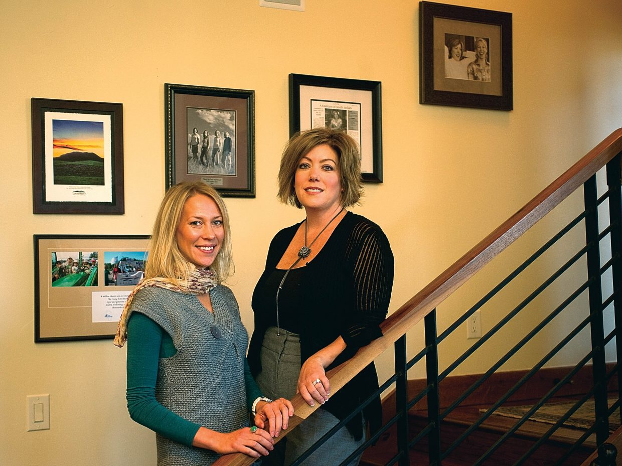 Trisha Benglen, administrative director, stands with Sara Craig-Scheckman, executive director, inside the offices of the Craig-Scheckman Family Foundation. The Craig –Scheckman Family Foundation will celebrate it's five year anniversary in December and has awarded in the neighborhood of $700,000 in that time.