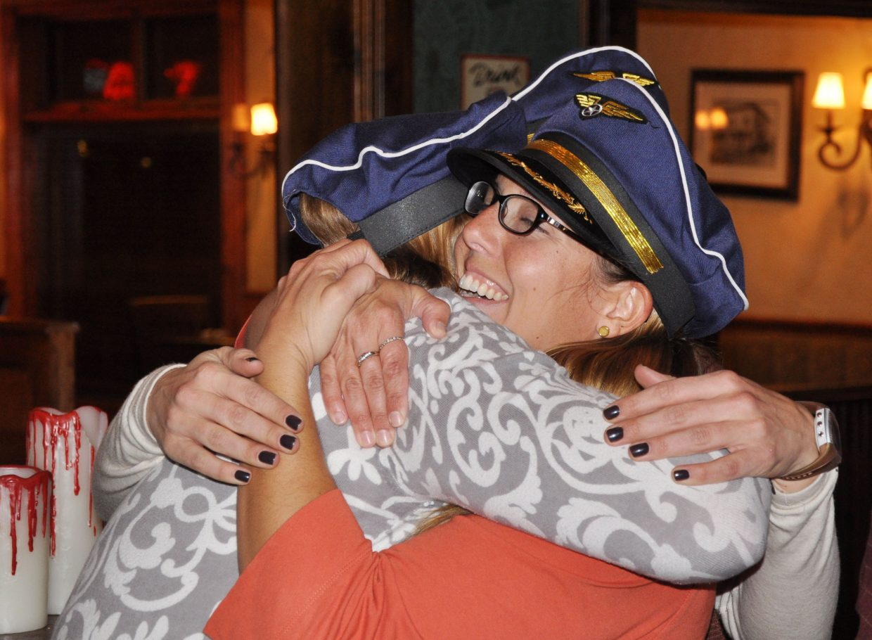 Steamboat Chamber Resort Association employees Marion Taylor and Kara Givnish hug Tuesday night after learning voters resoundingly passed Referendum 2B.