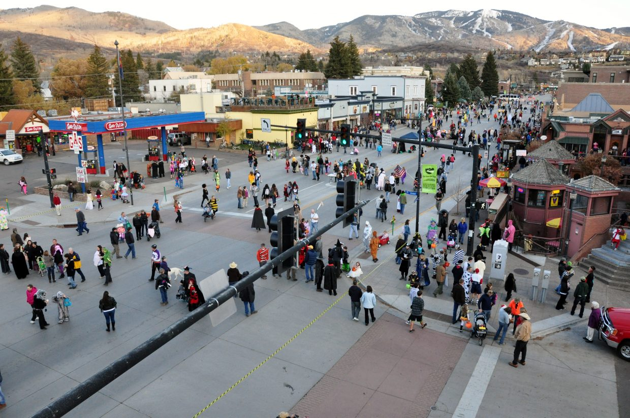 Halloween revelers walk down Lincoln Avenue Monday night during Steamboat's Downtown Halloween Stroll.