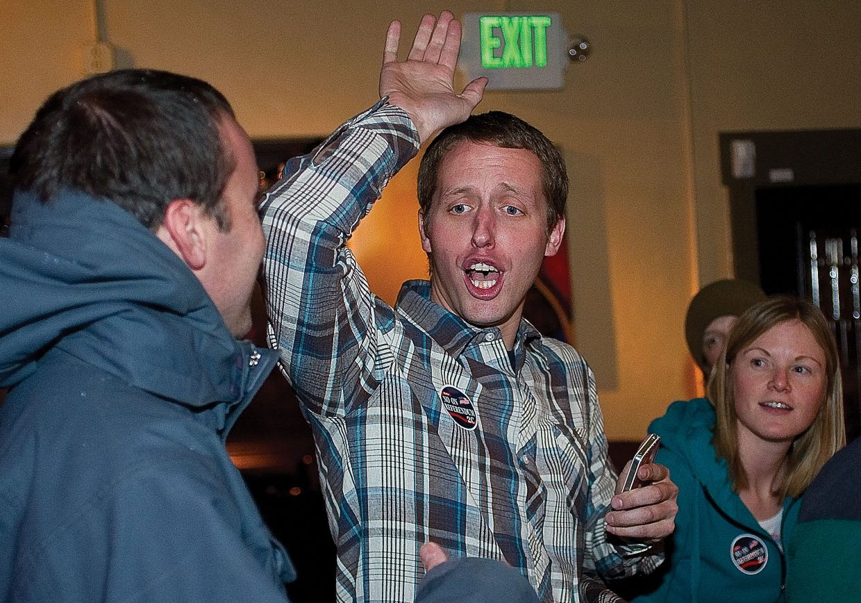 Kevin Fisher, co-owner of Steamboat Springs dispensary Rocky Mountain Remedies, celebrates with partner Ryan Fisher on Tuesday night as election results were tallied. Voters in Steamboat Springs and Routt County rejected bans on medical marijuana dispensaries.
