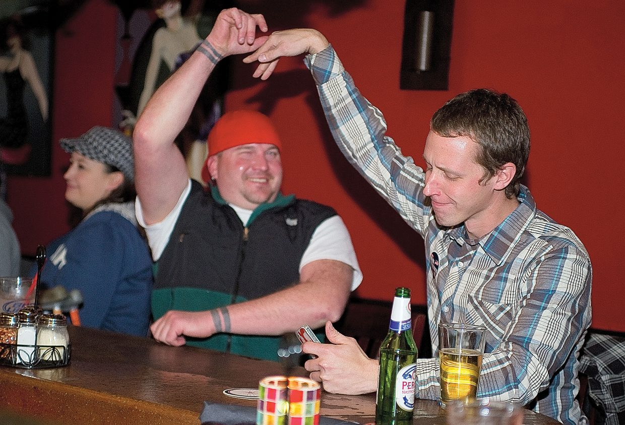 Kevin Fisher, co-owner of Steamboat Springs dispensary Rocky Mountain Remedies, gets a high-five from Josh Taylor on Tuesday night as election results were tallied. Voters in Steamboat Springs and Routt County rejected bans on medical marijuana dispensaries.